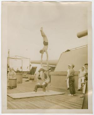 Primary view of object titled '[Photograph of Three Sailors Performing Acrobatics]'.