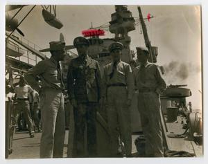 Primary view of object titled '[Photograph of Four Sailors on the U.S.S. Texas]'.