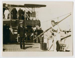 Primary view of object titled '[Photograph of a Captain W. G. Assetson Greeting Crew]'.