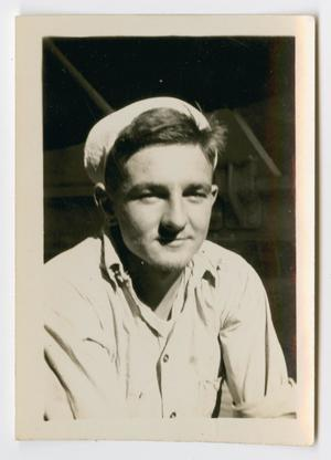 Primary view of object titled '[Photograph of a Sailor Wearing a Hat]'.