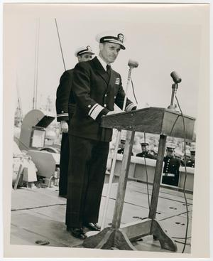 Primary view of object titled '[Photograph of a Navy Officer Giving a Speech]'.