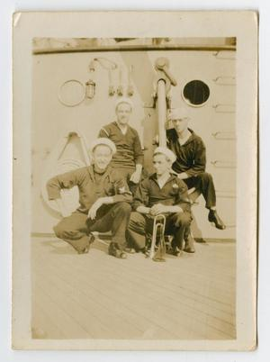 Primary view of object titled '[Photograph of Four Sailors on the Deck of the U.S.S. Texas]'.