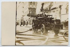 Primary view of object titled '[Postcard Showing a New York Fire Engine Responding to a Fire]'.