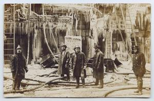 Primary view of object titled '[Postcard with a Photograph of Five Firemen by a Frozen Building]'.