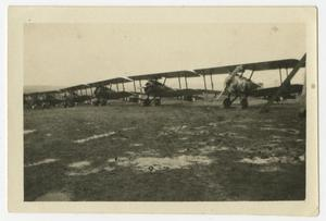 Primary view of object titled '[Photograph of a Row of Airplanes in a Field]'.