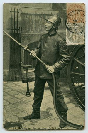 Primary view of object titled '[Postcard of a French Fireman with a Hose]'.