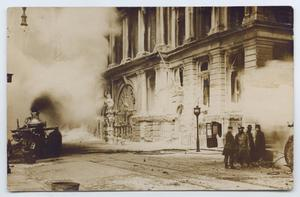 Primary view of object titled '[Postcard with a Photograph of Firemen Putting out a Fire]'.