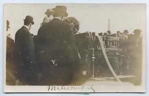 Primary view of object titled '[Postcard with a Photograph of Milwaukee Firemen and a Truck]'.