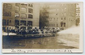 Primary view of object titled '[Postcard with a Photo of the Milwaukee Fire Department Testing Equipment]'.