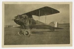 Primary view of object titled '[Photograph of a Pilot Working on His Plane]'.