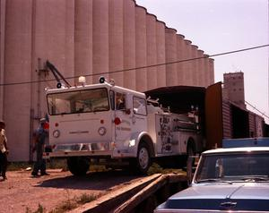 Primary view of object titled '[Unloading New Fire Truck]'.