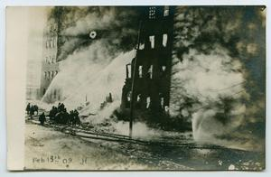 Primary view of object titled '[Postcard with a Photograph of a Large Building on Fire]'.