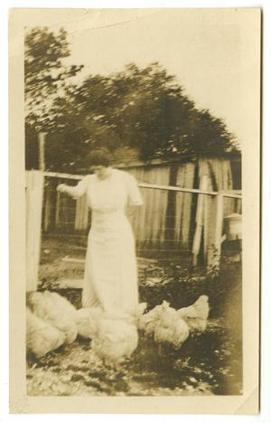 Primary view of object titled '[Photograph of Ida Caldwell McFaddin Feeding Chickens]'.
