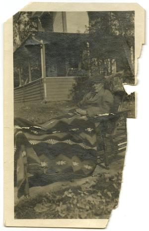 Primary view of object titled '[Photograph of Forée Dabney Caldwell, Sr. Lounging]'.