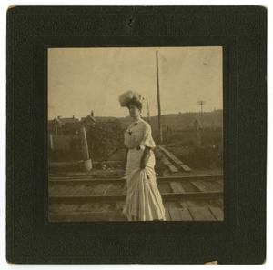 Primary view of object titled '[Photograph of Ouida Caldwell Watts near Railroad Tracks]'.
