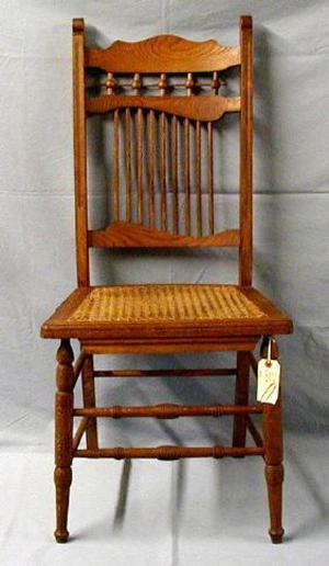 Primary view of object titled '[Stick and ball armless oak chair, higher angle shot]'.