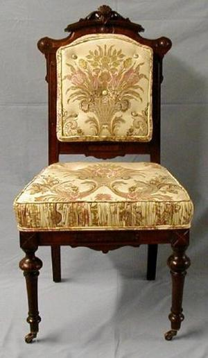 [Silk cream-colored parlor chair, legs slightly crooked]