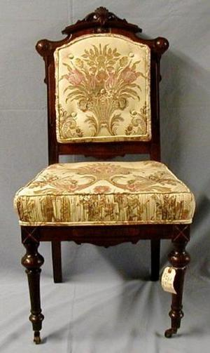 [Silk cream-colored parlor chair, legs slightly turned inward]