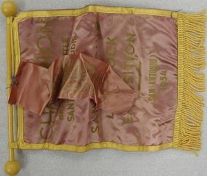 Primary view of object titled '[Mauve banner with a yellow border and  yellow fringe at bottom]'.