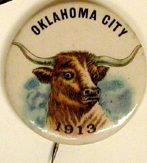 [Cream button with image of a longhorn on front]