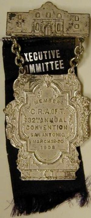 Primary view of object titled '[Two tiered San Antonio livestock pin and purple executive committee ribbon]'.