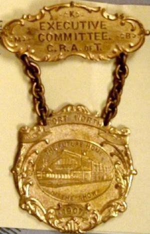 Two tiered gold Fort Worth livestock executive committee pin