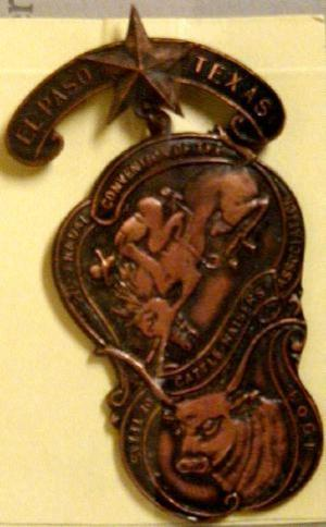 Primary view of object titled '[Two tiered bronze El Paso livestock pin]'.
