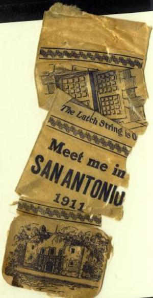 "[Beige silk ribbon that states: ""The Latch String is O_  Meet me in SAN ANTONIO 1911""]"