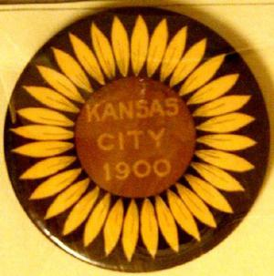 "Primary view of object titled '[Button sunflower on black background reads: ""KANSAS CITY 1900""]'."