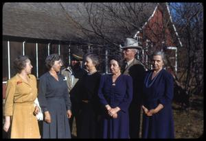 Primary view of object titled '[Family Standing Outside of Ranch Cookshack]'.