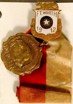 Primary view of object titled '[Gold medal with red and white ribbon]'.