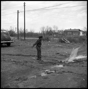 Primary view of object titled '[Boy in a Muddy Driveway]'.
