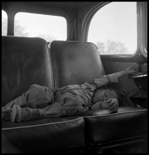 [Child Sleeping in a Car]