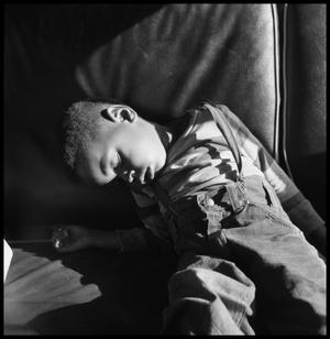 Primary view of object titled '[Child Sleeping in a Car]'.