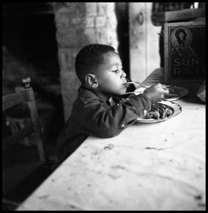 [Child Eating at a Table]