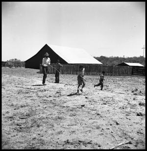 Primary view of object titled '[Jack Newcomb Catching a Child with a Rope]'.