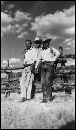 [Three Cowboys Leaning on Fence]