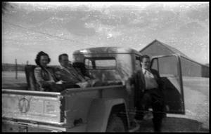 Primary view of object titled '[Family Members Posing in Pick-up Truck]'.