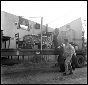 Primary view of object titled '[Parade Float Representing a Home]'.