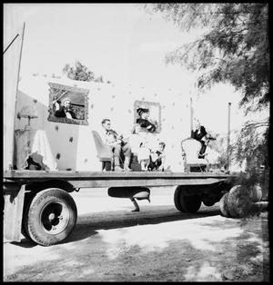 Primary view of object titled '[Parade Float Representing a Sitting Room]'.