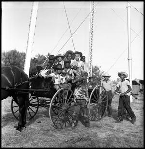 Primary view of object titled '[Children in a Wagon]'.