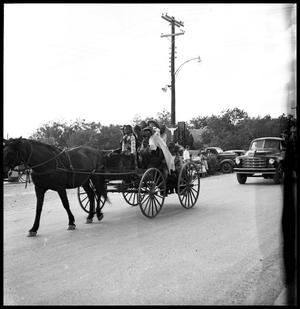 Primary view of object titled '[Photograph of a Family on a Horse Drawn Wagon]'.