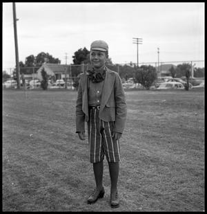 Primary view of object titled '[A Boy Wearing a Costume in a Field]'.