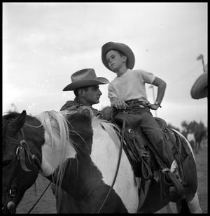 [Boy Atop a Horse with a Man Nearby]