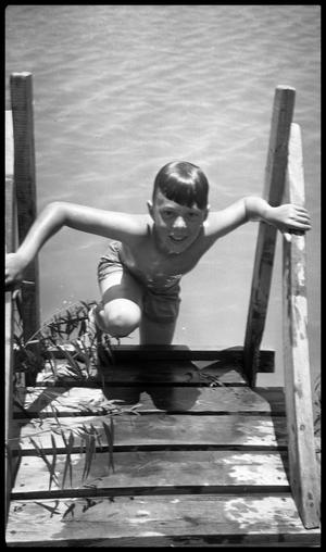 Primary view of object titled '[Boy Climbing Out of Water]'.