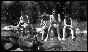 Primary view of object titled '[Four People in Swimsuits Sitting on a Log]'.