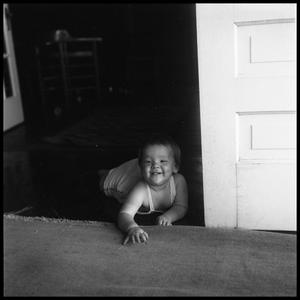 Primary view of object titled '[Baby Crawling on a Floor]'.