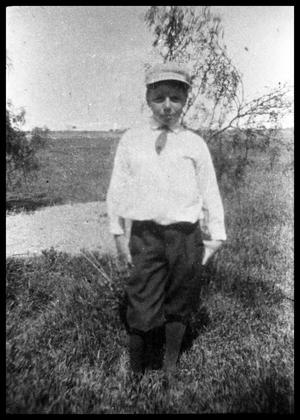 Primary view of object titled '[Boy Standing in Rangeland]'.