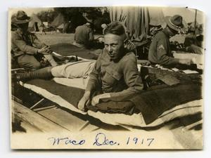 [Photograph of Soldier on Cot]