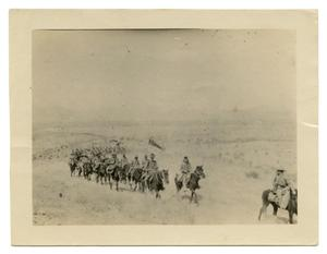 [Photograph of Soldiers Riding in a Long Line]